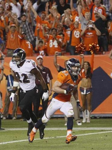 Wes Welker hauled in a pair of scoring passes in his Broncos debut.